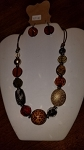 18 inch beaded necklace on brown cord chain with matching earrings