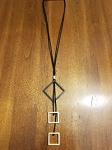 long black cord necklace with 3 pendants