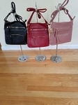 crossbody purses with 2 zipper front pouches and zipper main closure.   11 1/2 x 10
