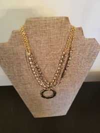 gold strand necklace with pendant drop