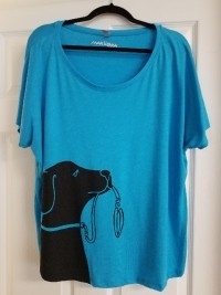 turquoise shirt with black dog